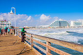People fishing and strolling on the Daytona Beach Pier, one of the main tourist landmarks of this city of Florida.