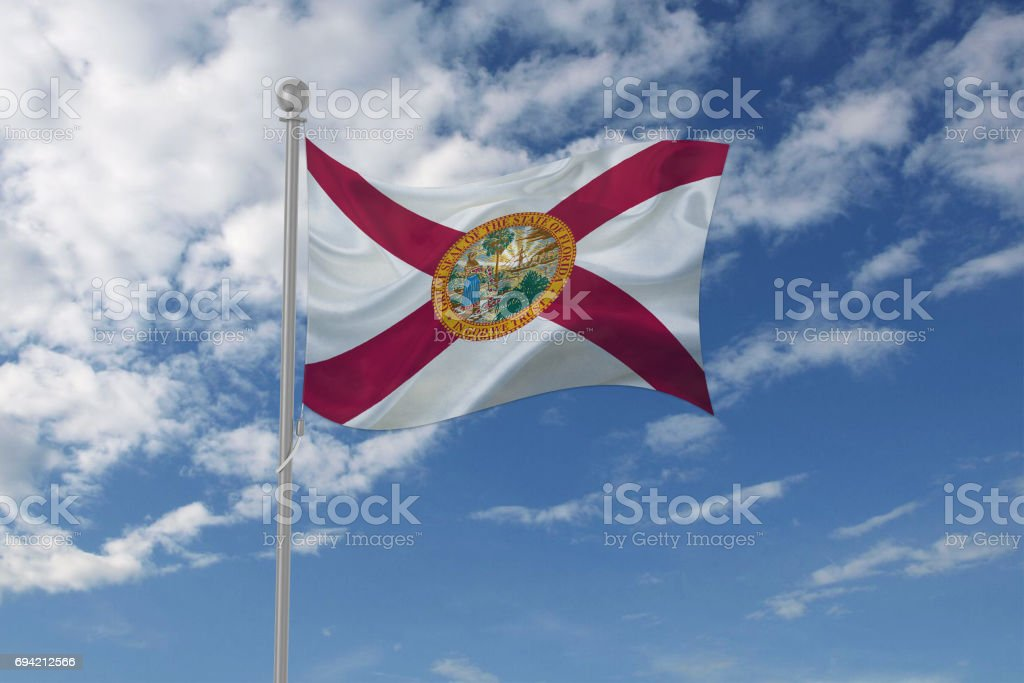 Florida flag waving in the sky stock photo