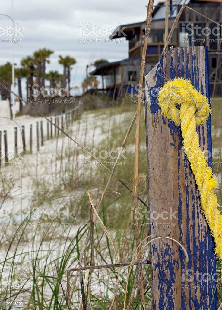 Florida Gulf Coast Beach Yellow Rope Post Stock Photo