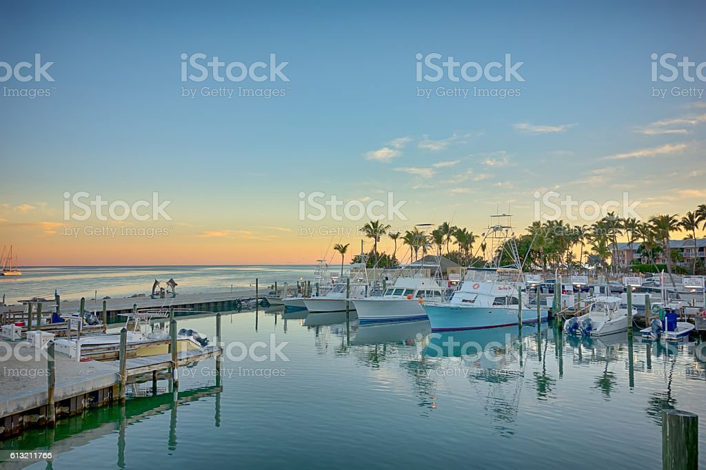 Florida Keys fishing boats in turquoise tropical blue water stock photo
