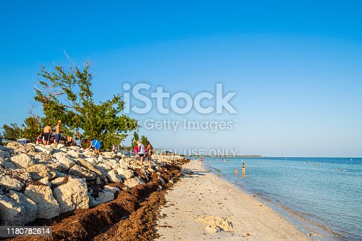 Tourists relaxing at Loggerhead Beach in the Bahia Honda State Park, lower Florida Keys.