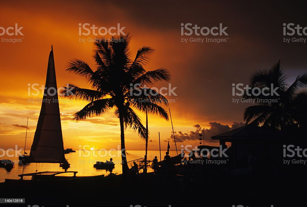 Florida Keys sunset with boats, palms stock photo