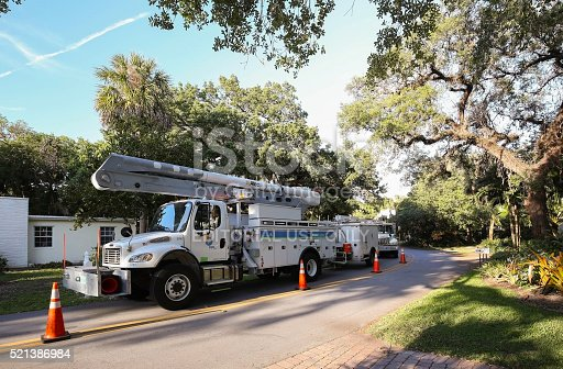 istock Florida Power and Light trucks parked on a residential street 521386984