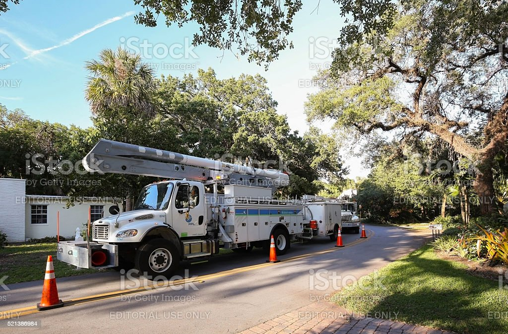 Florida Power and Light trucks parked on a residential street stock photo