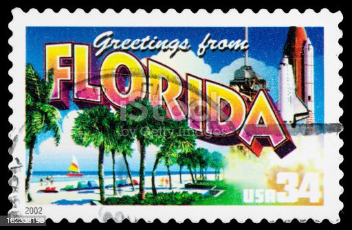 Florida State Postage Stamp Greetings From America Retro Postcard Theme. This Postage Stamp Program celebrated each of the 50 USA States with a retro postcard theme. These Colorful 32 cent stamps were released on April 4, 2002. The retro design of these stamps resembles the large letter postcards that were popular with tourists in the 1930's and 1940's and conveys a nostalgia for all aspects of popular American culture