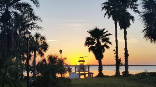 Florida Sunset with Docked Boat stock photo