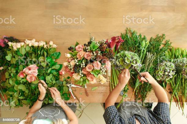 Florist and assistant in flower shop delivery make rose bouquet table picture id846668708?b=1&k=6&m=846668708&s=612x612&h=f0rcewohhzh o6dou3mmc1b04zdm7odks8npbu aqhs=