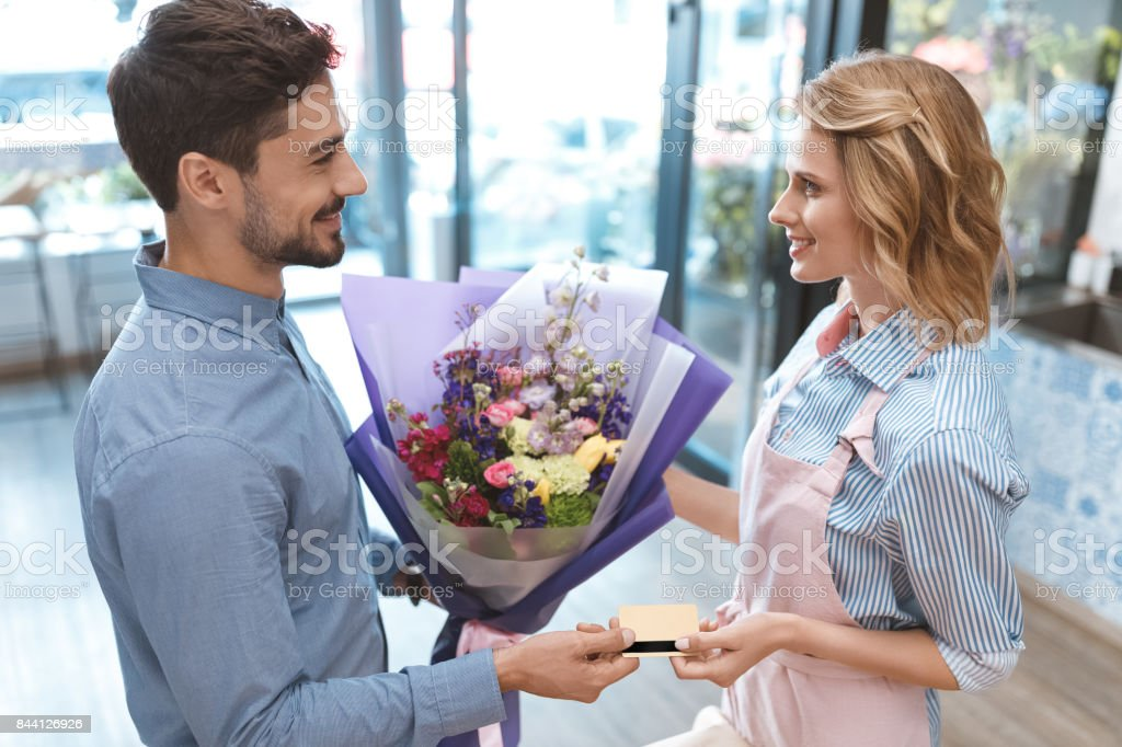 florist and client with credit card stock photo