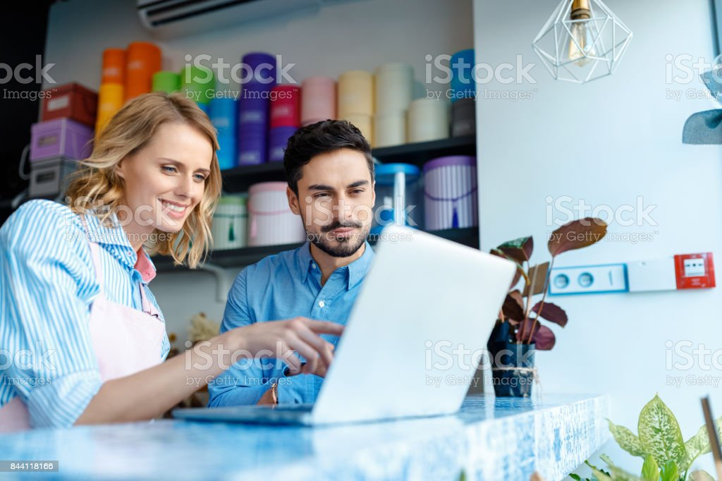 florist and client with laptop stock photo
