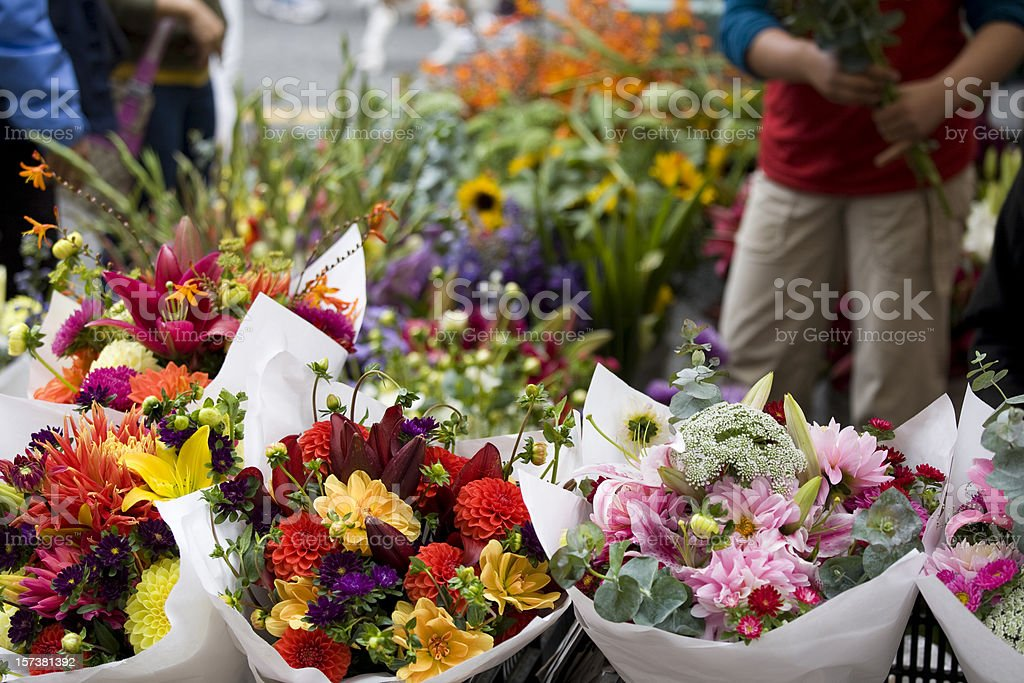 Florist and Fresh flowers at an outdoor flower market stock photo