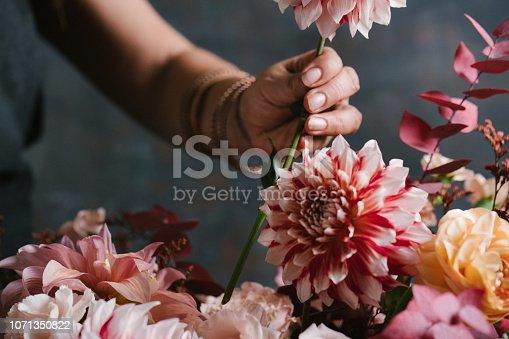 Florist making flower arrangements in her shop