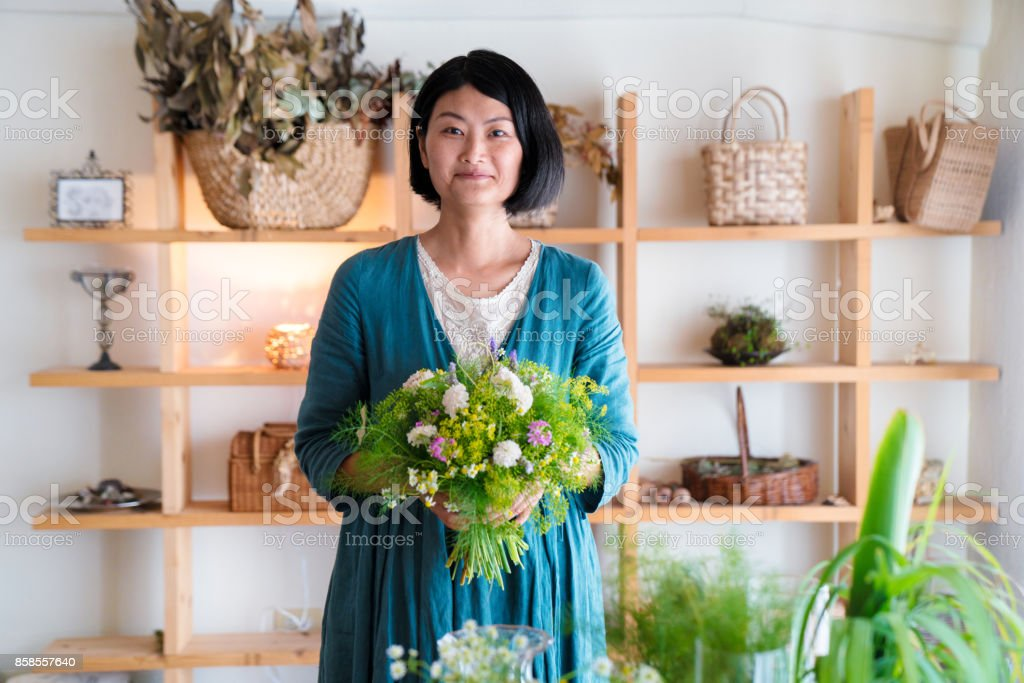 Florist at the shop stock photo