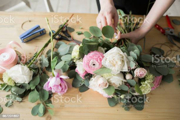Florist At Work Pretty Young Woman Making Fashion Modern Bouquet Of Different Flowers Stock Photo - Download Image Now