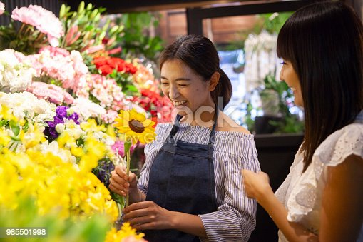 istock A florist clerk and a young guest. 985501998