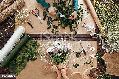 Top view of florist creating flower display