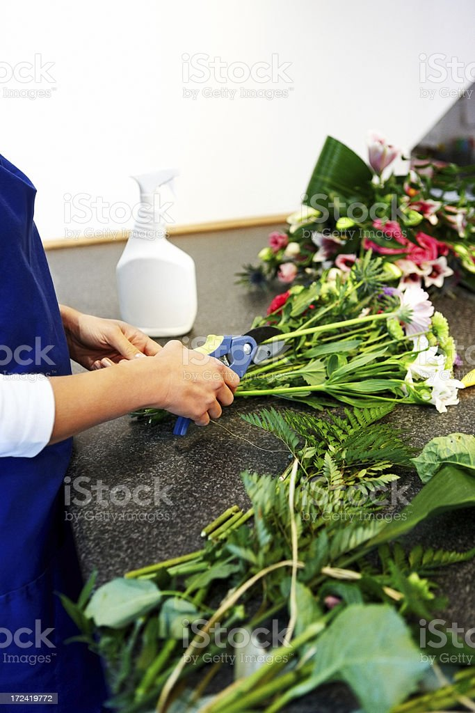 Florist hands making bouquet in shop royalty-free stock photo