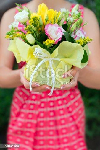 Florist hands showing bouquet flowers shop market