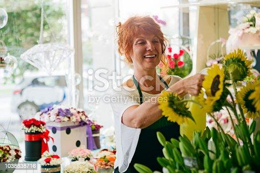 Florist in flower shop arranging