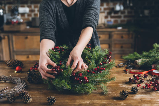 florist making Christmas wreath of fir branches stock photo