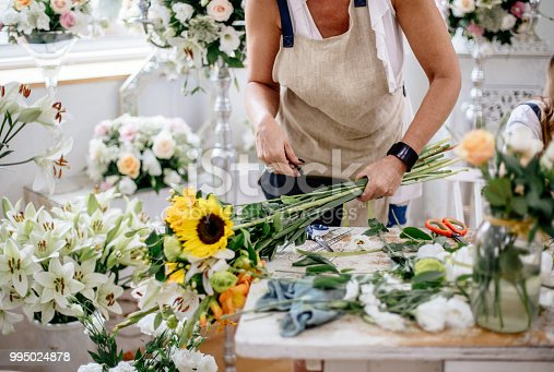 Florist making floral arrangement