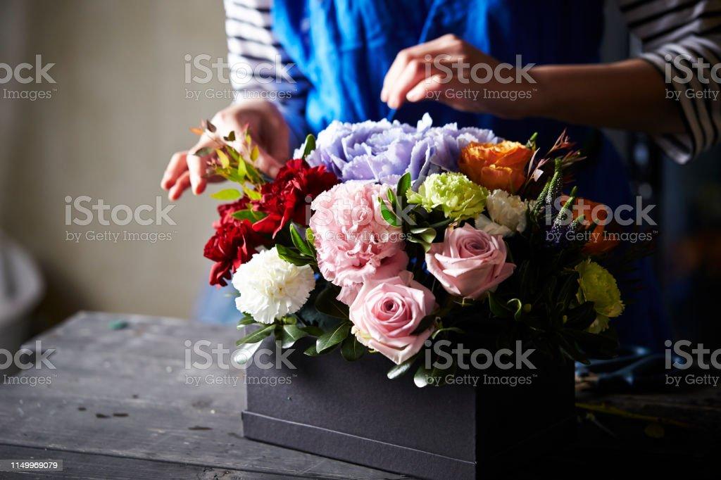 Florist making flower box