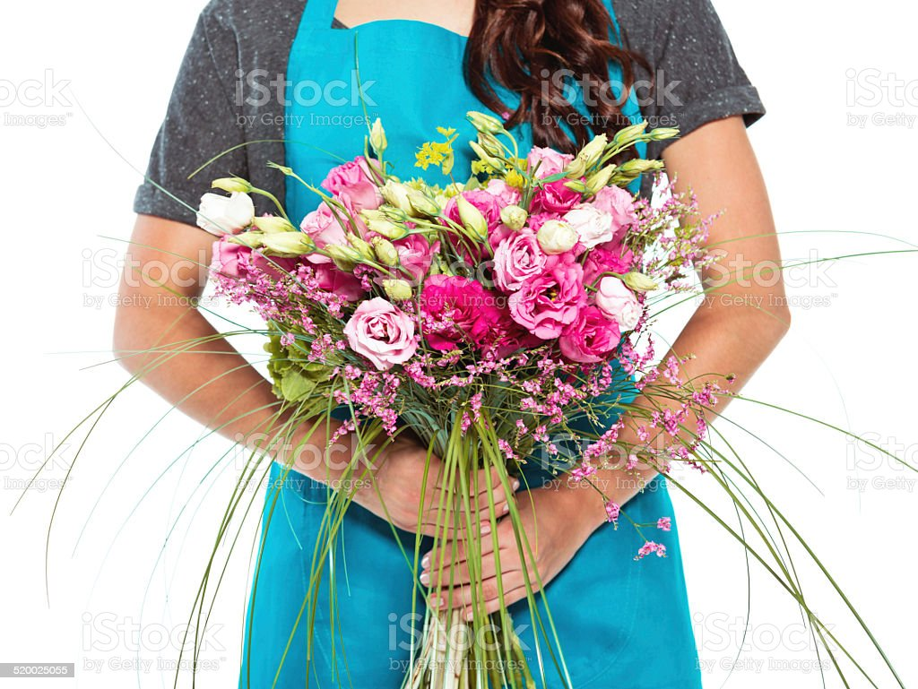 Florist Florist holding bouquet in hands. Close up of flowers. Studio shot, white background. Adult Stock Photo