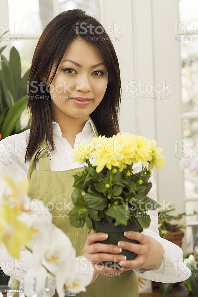 Florist Selling Flower in her Shop royalty-free stock photo
