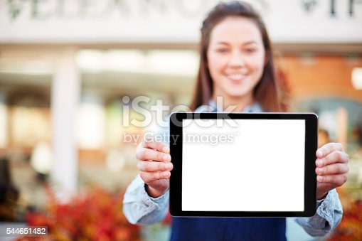 863476166istockphoto Florist showing digital tablet with blank screen 544651482