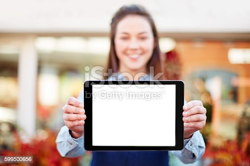 863476166istockphoto Florist showing digital tablet with blank screen 599500656