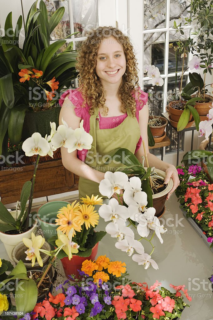 Florist Small Business Owner in Her Flower Shop royalty-free stock photo