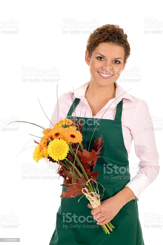 Florist with green apron holding a pretty bouquet royalty-free stock photo