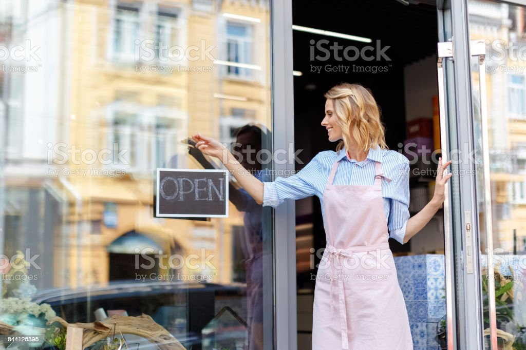 florist with open sign stock photo