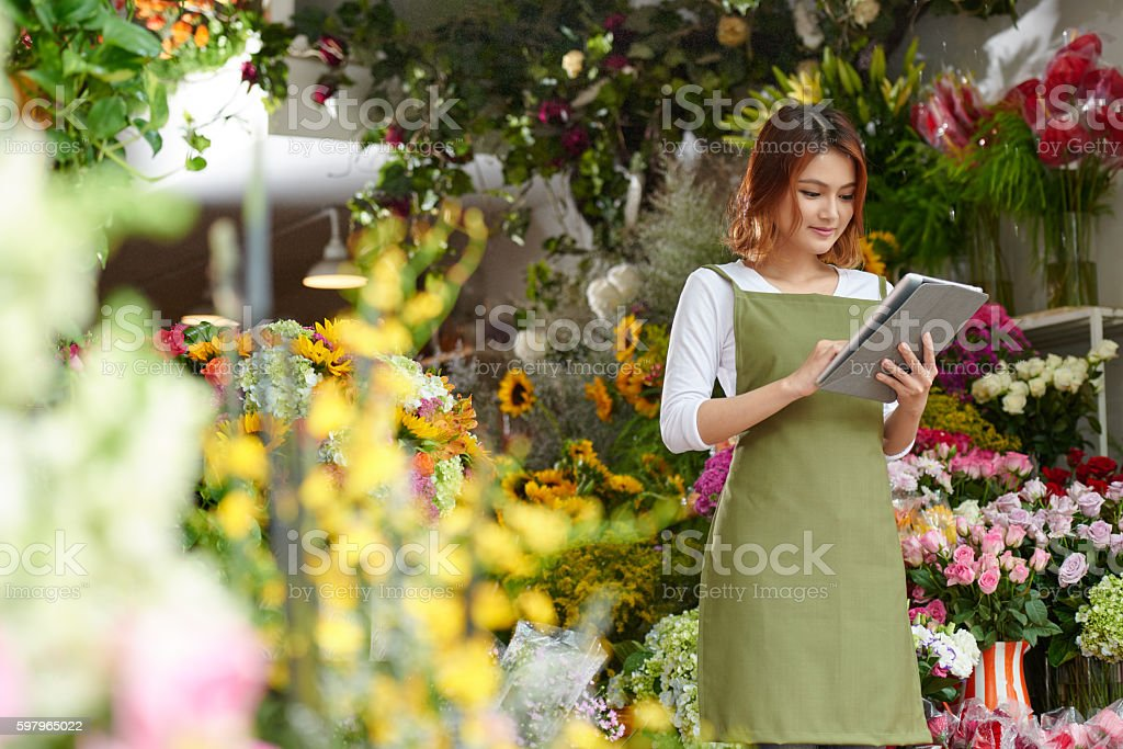 Florist with tablet stock photo