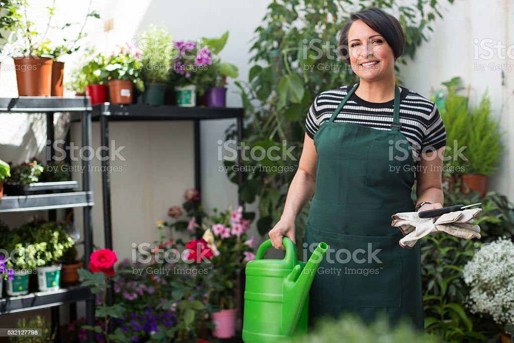 Florist with tools in the gardening store stock photo