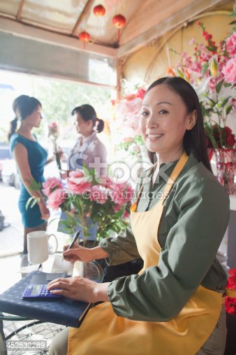 1066358064 istock photo Florist Working In Flower Shop 452532289