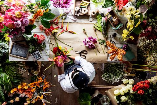 Florist working on flower arrangement among the flower