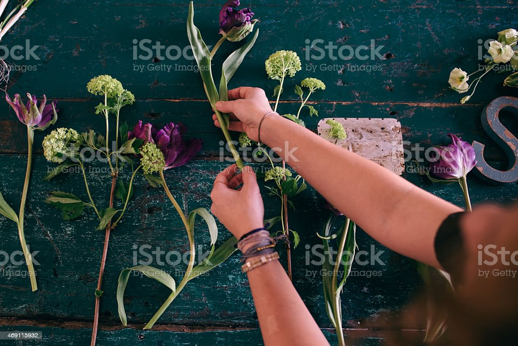 Florist workspace: woman making floral decorations stock photo