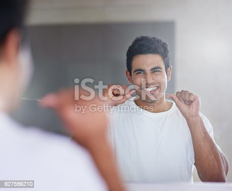 istock Flossing for a complete clean 627586210