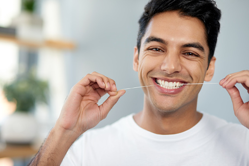 istock Flossing for healthier teeth 1151973585