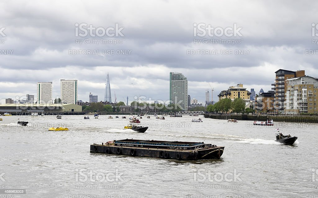 Flotilla of small boats with Royal Marines in the Thames stock photo