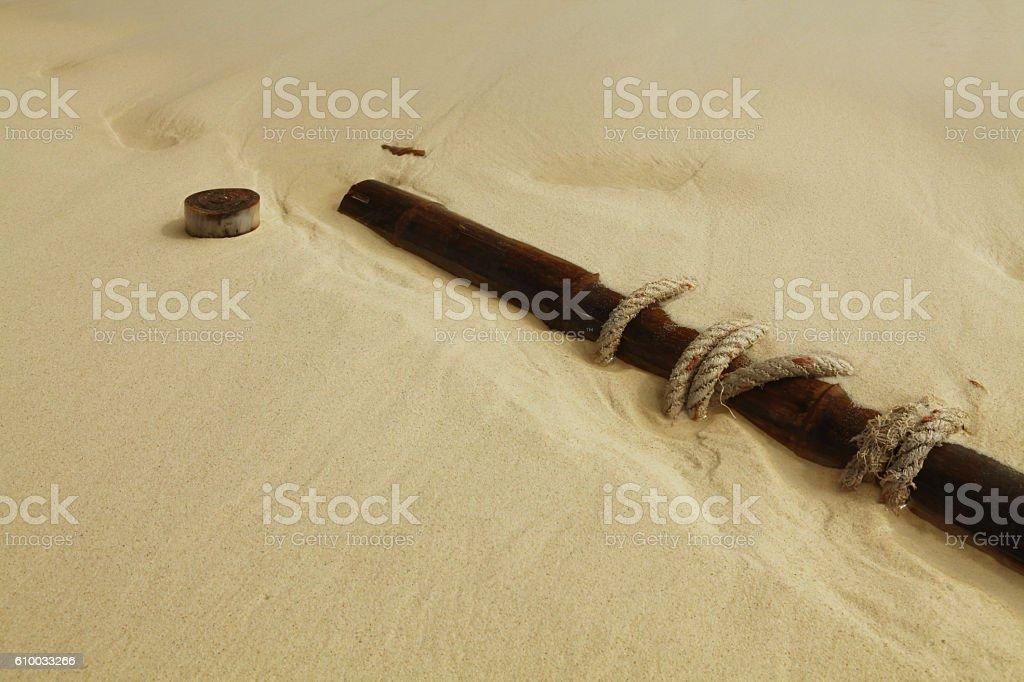 flotsam on sand stock photo