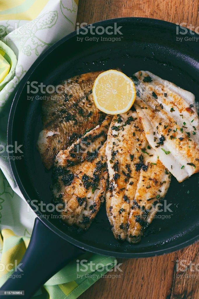 Flounder fillet roasted in a skillet stock photo