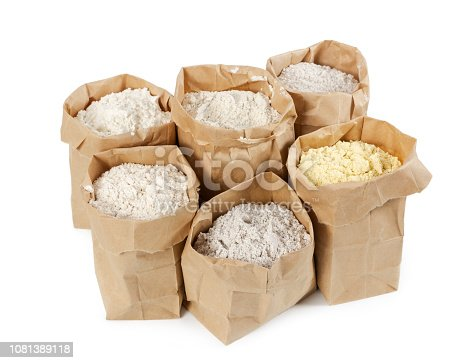 912671588istockphoto Flour and flour mixture in paper bags isolated on white 1081389118