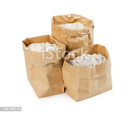 912671588istockphoto Flour and flour mixture in paper bags isolated on white 1081389120