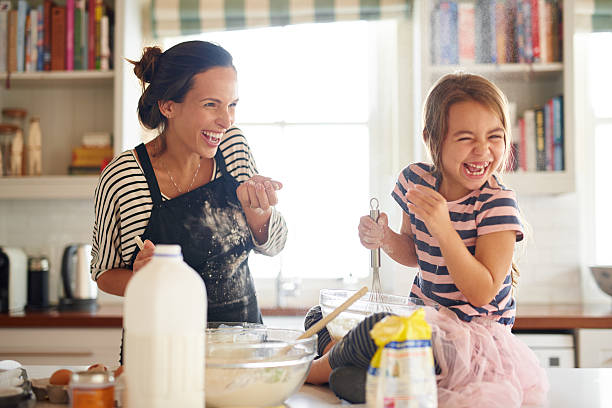 flour and fun make for some delicious food! - kids cooking stock photos and pictures