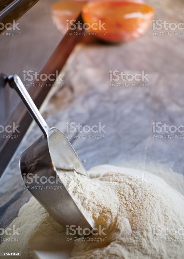 Flour and serving scoop in a kitchen stock photo