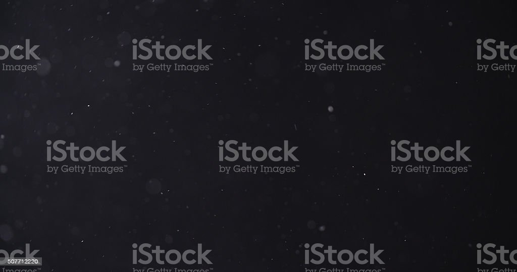 flour dust particles on black background royalty-free stock photo