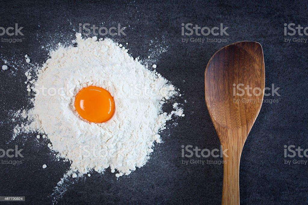 Flour Egg Wooden Spoon stock photo