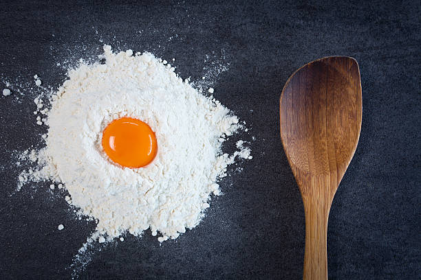 Flour Egg Wooden Spoon stock photo