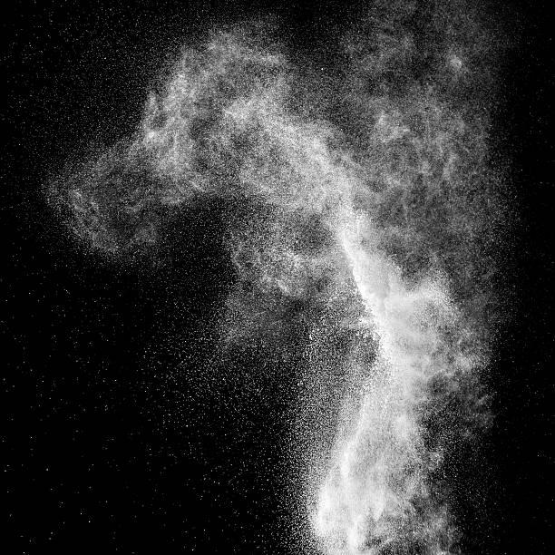 flour explosion on black background - talk stockfoto's en -beelden